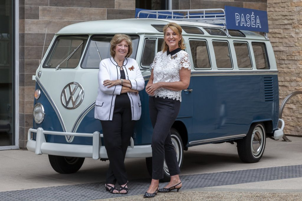 AFC CEO Joanna Richardson-Jones and AFC Board Chair Mary Lou Shattuck infront of the Pasea Hotel Volkswagen Bus