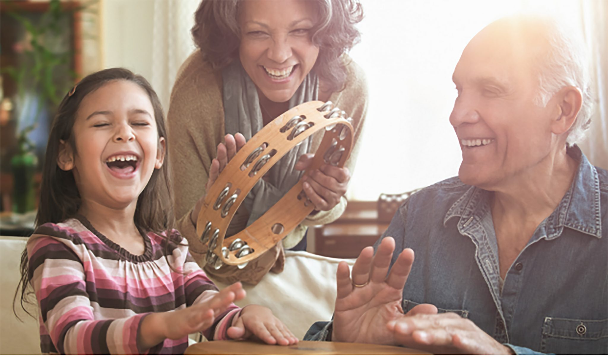 happy child with grandparents - we can help with dementia and depression